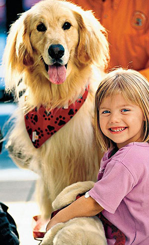 Young girl patient with Josh the golden retriever